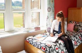 Girl in her dorm room