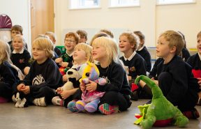 Barnard Castle School children having fun in assembly