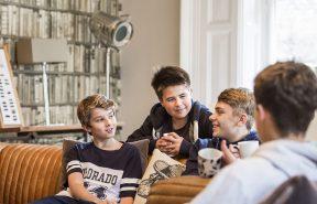 Boys talking in common room